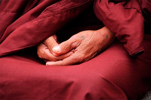 Elderly hands clasped in prayer