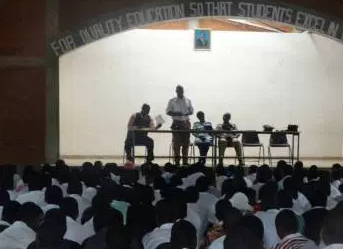 A group of people present in an auditorium