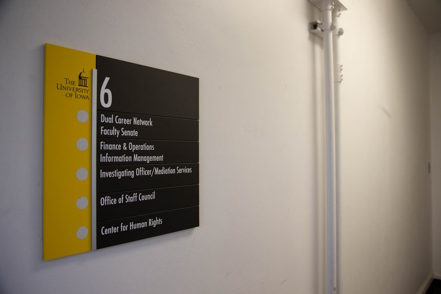 A directory sign outside of the Center for Human Rights at the University of Iowa