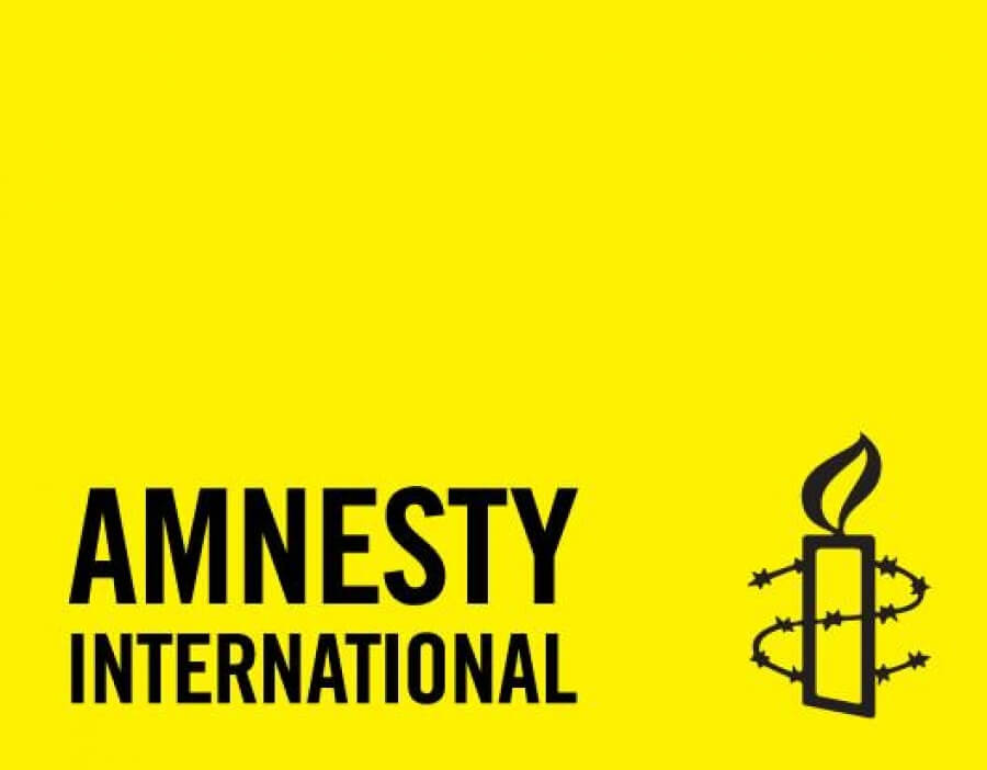 The logo for Amnesty International