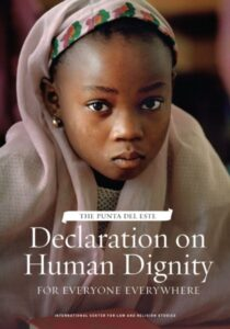 """A picture of the cover of the """"Declaration on Human Dignity for Everyone Everywhere"""" by The Punta Del Este. The cover shows a young girl."""